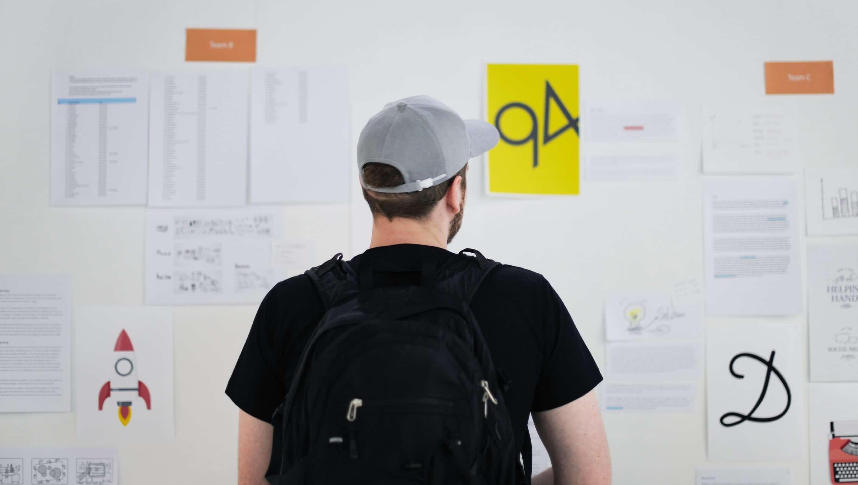 Student looking at bulletin board